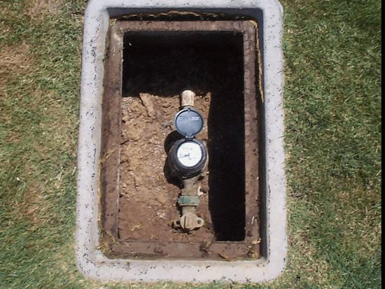 "This is a photo of the actual water meter. In most homes the meter is usually located in the ground near the curb. You should see a metal top marked ""Water Meter."" If in doubt - call a licensed, qualified plumber to come take a look."