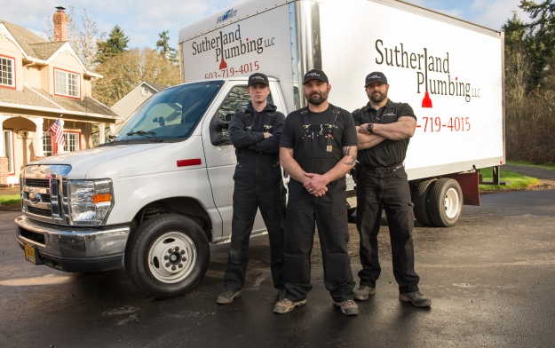 Ti Sutherland with his Sutherland Plumbing crew members, John Benton (right) and Sean Anderson.
